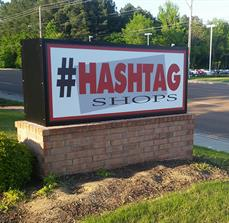 Hashtag Shops Monument Sign