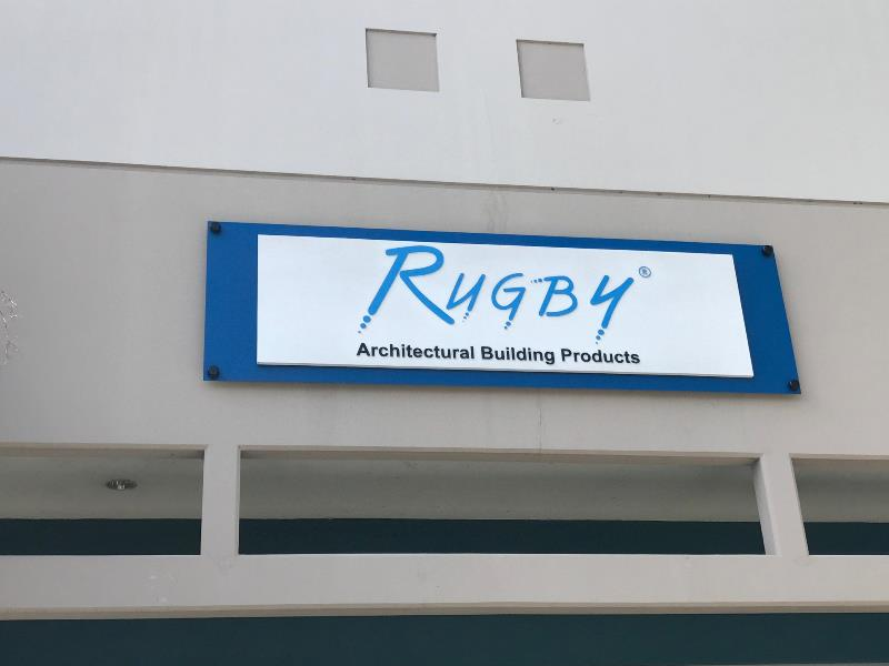 Building wall signage with standoffs for architetural building products business