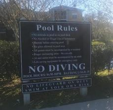 Safety signs for pools and recreational areas within communities