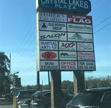 Pylon signage with multiple tenant panels for busy shopping centers