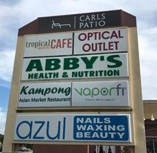 Refreshed tenant panels on multi-tenant pylon signs
