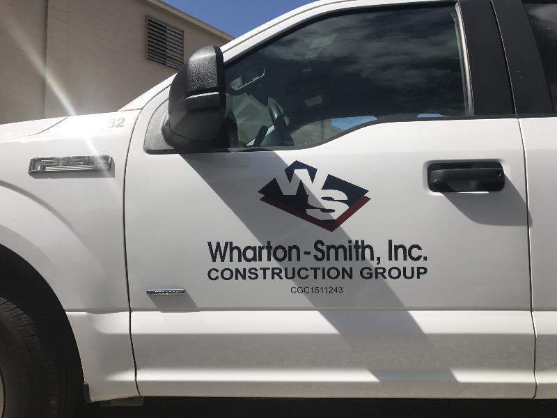 Truck door vehicle graphics for contractors