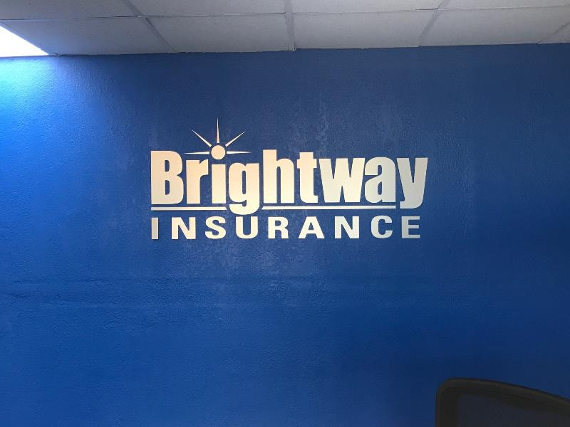 Accent walls and vinyl lettering for branding wthin office spaces