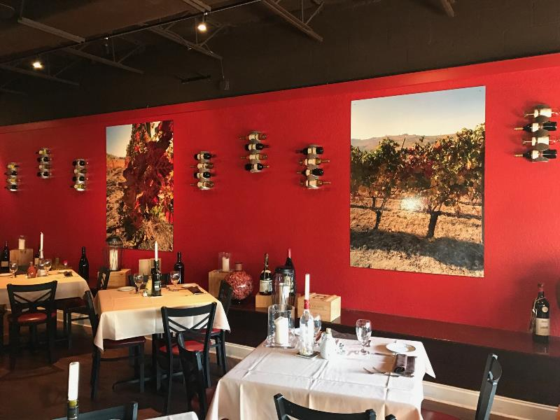 Restaurant wall signage with standoffs designed to create mood