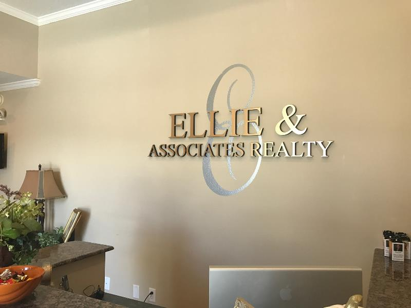 Wall signage for offices that mix vinyl graphics and dimensional letters