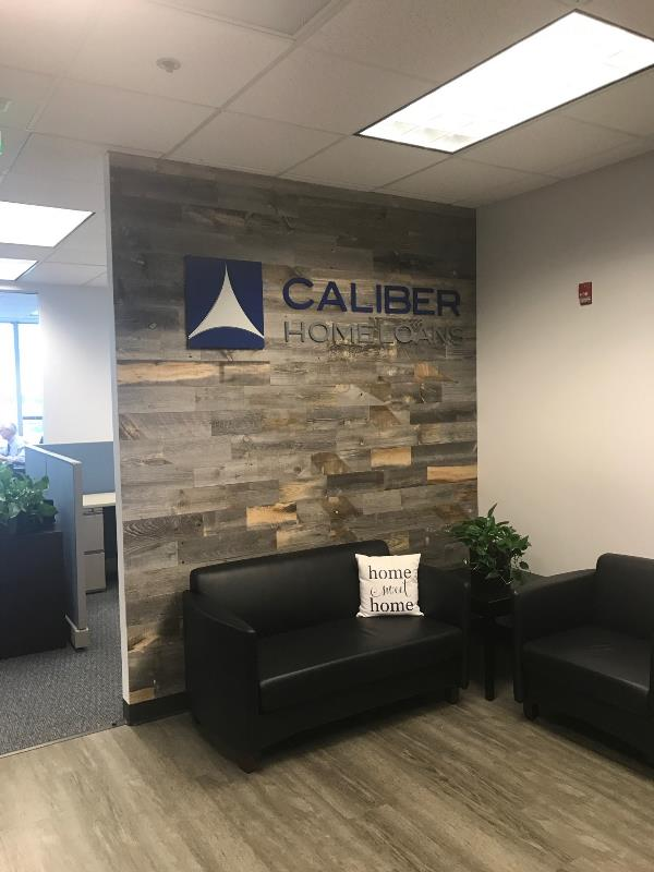 Wood accent wall and dimensional letters for home loan office