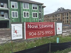 Exterior Now Leasing Banner