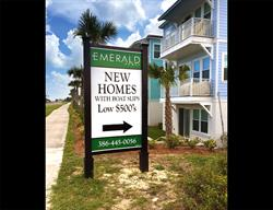 Custom Directional Site Sign for a Home Builder Produced and Installed by FASTSIGNS Baymeadows.