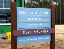 Custom Site Sign with Tracks for a Home Builder Produced and Installed by FASTSIGNS Baymeadows.