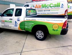 Truck Graphics for a Fleet of  Vehicles Created, Printed and Installed by FASTSIGNS Baymeadows.