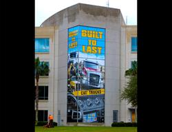 Huge Graphics Printed on  Vinyl and Installed on 5 Story Building by FASTSIGNS Baymeadows.