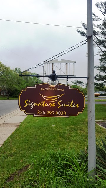 Signature Smiles Hanging ID sign