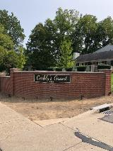 Brick monument entrance sign with custom curved brushed metal dimensional letters