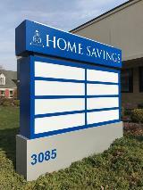 Custom aluminum tenant panel sign for business center building