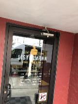 Business hours and logo installed on glass door
