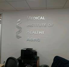 Dr. Kim Logo Wall Sign with brushed aluminum on acrylic