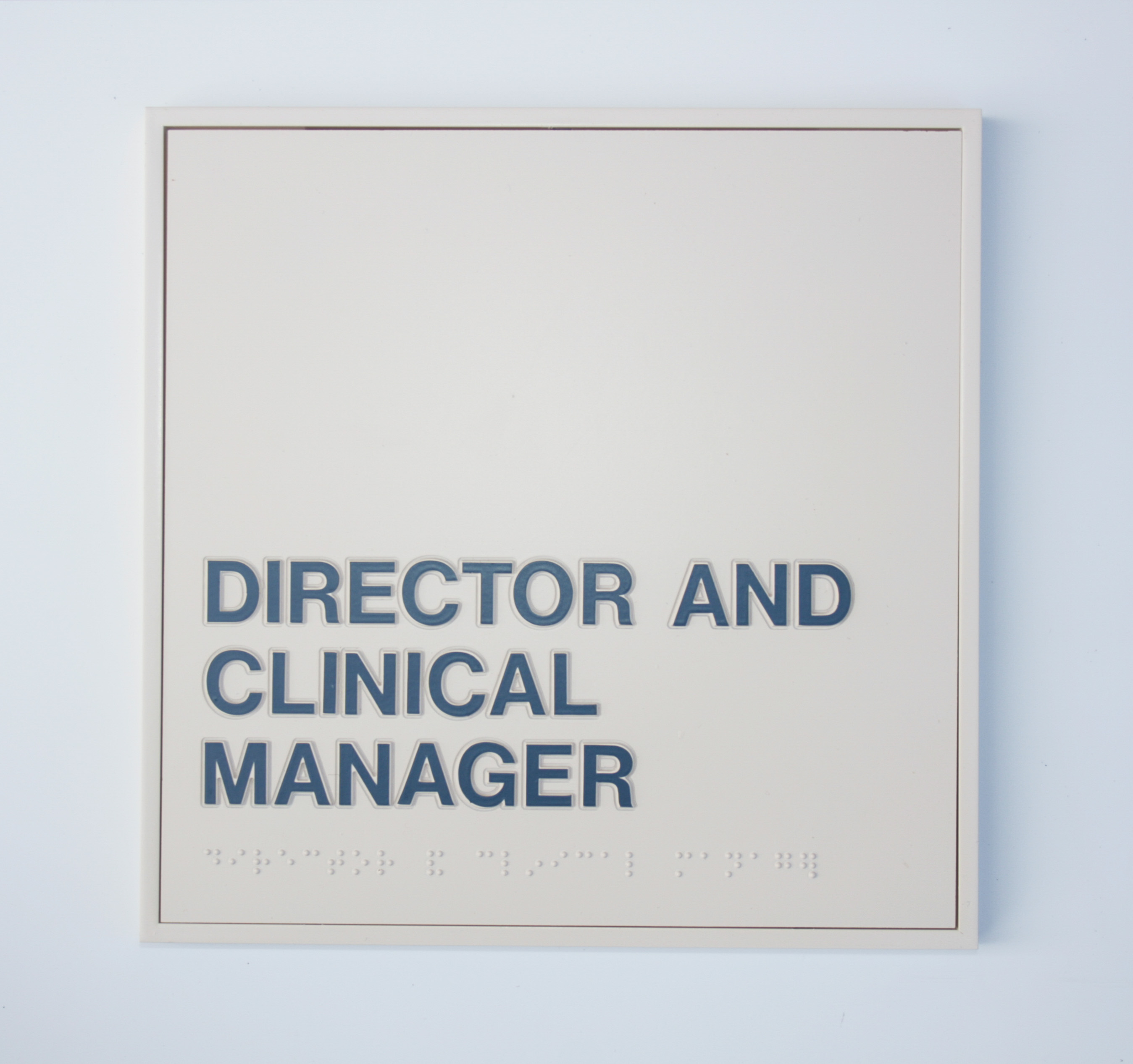 Director Braille Sign