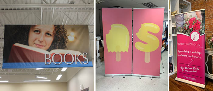 Various banner stands in retail spaces.