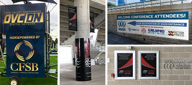 A collection of sponsor graphics and images installed on bare walls or pillars.