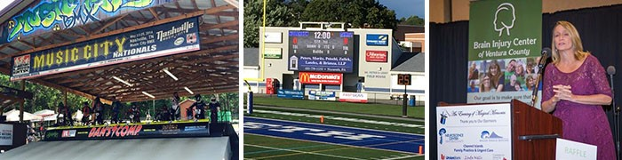 A group of sponsor banners and graphics installed in prominent sightlines.