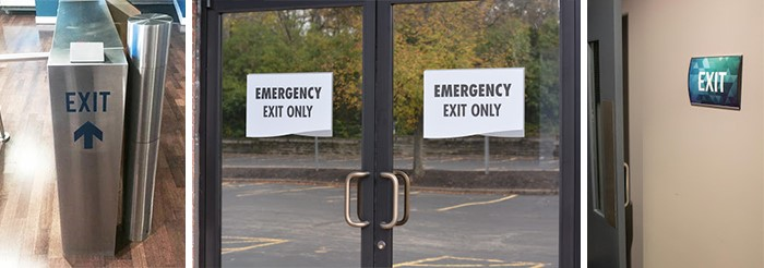 Exit signs on turn style gates and doors used for an event.