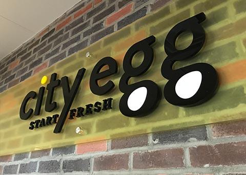 city-egg-wall-signage