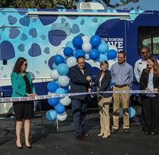 Bus Graphics and Ribbon Cutting