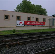 Assured Automotive Building Banner