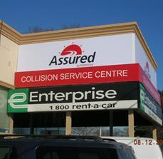 Assured Automotive Building Sign